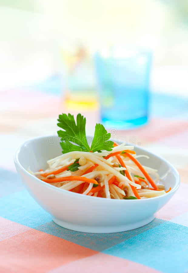 Kohlrabi and carrot salad. On the plate royalty free stock images