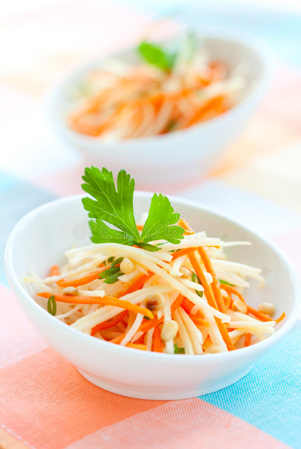 Kohlrabi and carrot salad. With pine nut,parsley and green onion royalty free stock image