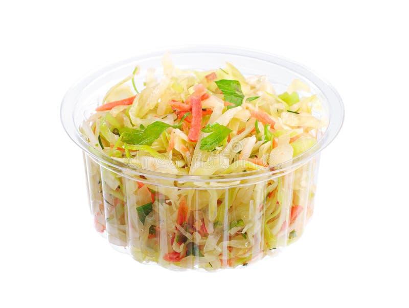 Kohlsalat in einem Kunststoffgehäuse stockfotografie