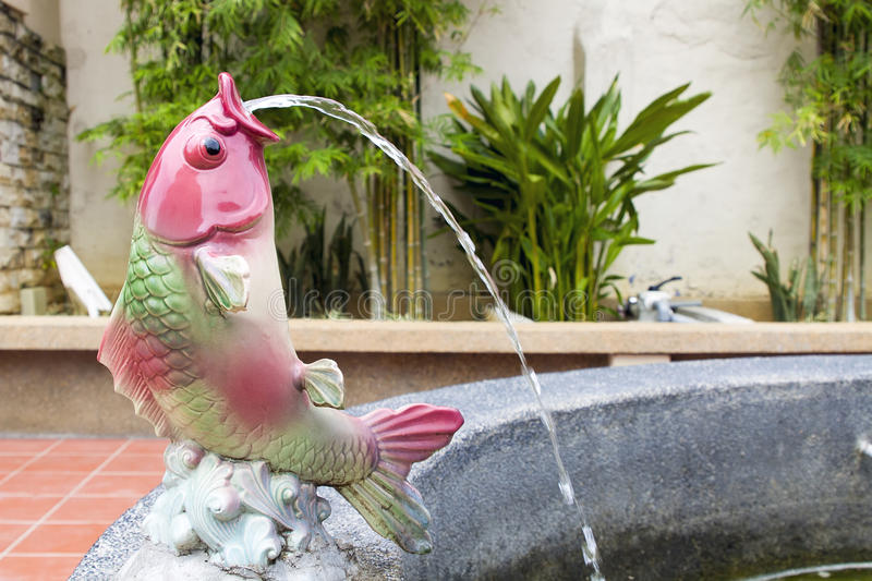 Koi Fish Statue Water Fountain. Koi Fish Statue Sprouting Water on Fountain Pond royalty free stock images