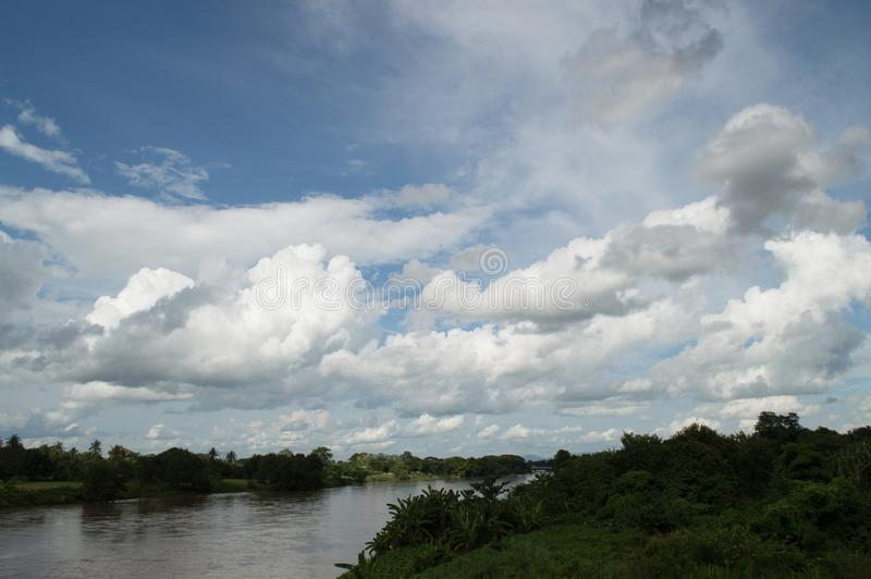 Kok river, trees and cloud on blue sky, natural concept. Beautiful abstract of blue sky and cloud, used as background and texture. Take photography at Kok stock photo