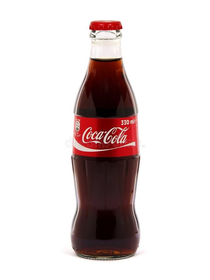 koka-kola szklana butelka 330 ml, odizolowywająca na białym tle obraz stock