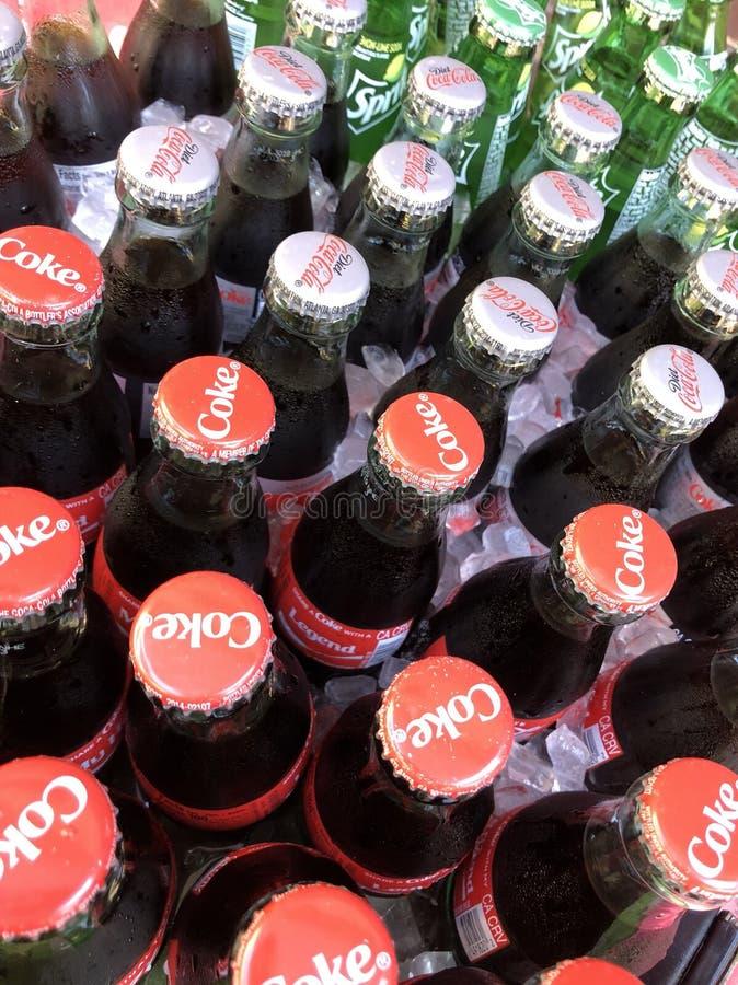 Koka-kola w butelkach w lodzie zdjęcie stock