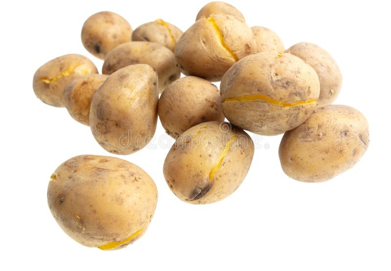 Kokade potatisar som isoleras på vit bakgrund arkivbild