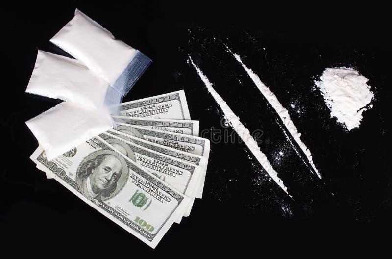 Kokain och dollar royaltyfri bild
