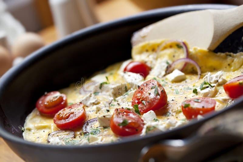 Kokende Omelet stock foto's