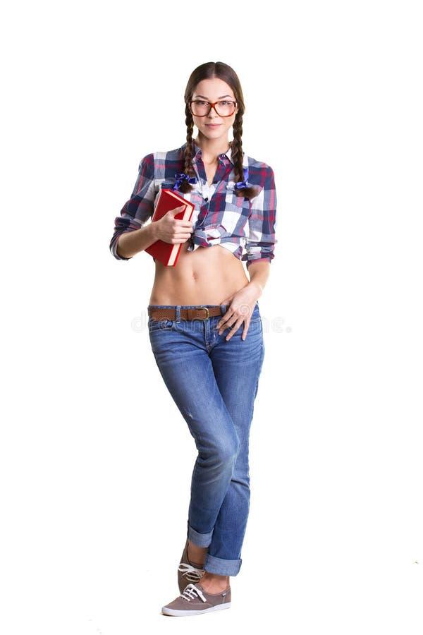 Kokett flicka med böcker royaltyfri bild