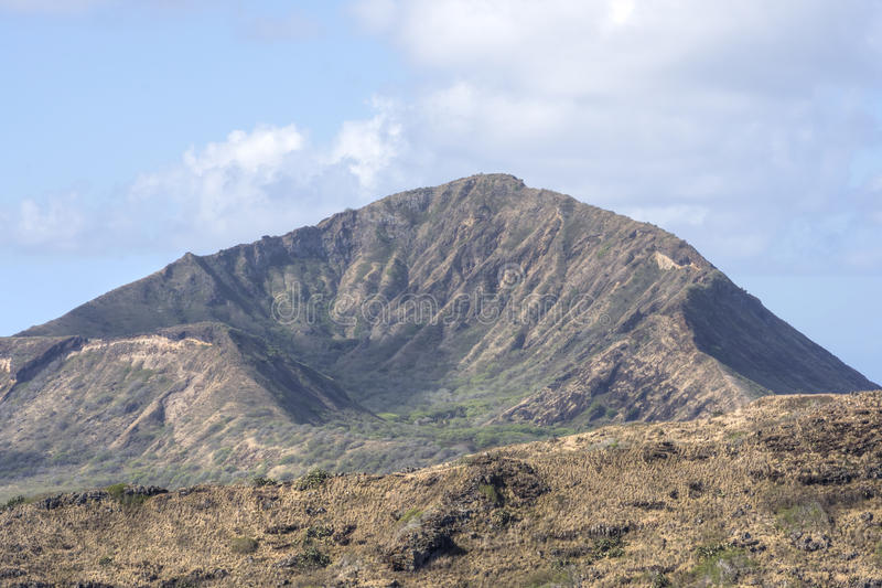 Koko Crater volcanic tuff cone on Oahu. Eastern side of Koko Crater on sunny day shot with telephoto lens on Oahu stock images