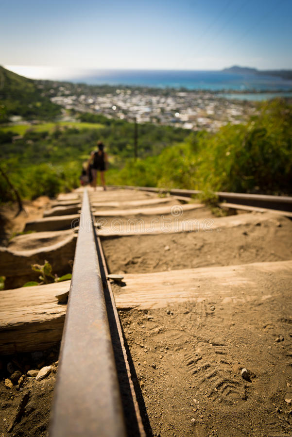 Koko Head Crater and hikers. Koko Heads Crater and hikers attempting to climb its 1048 steps royalty free stock photography