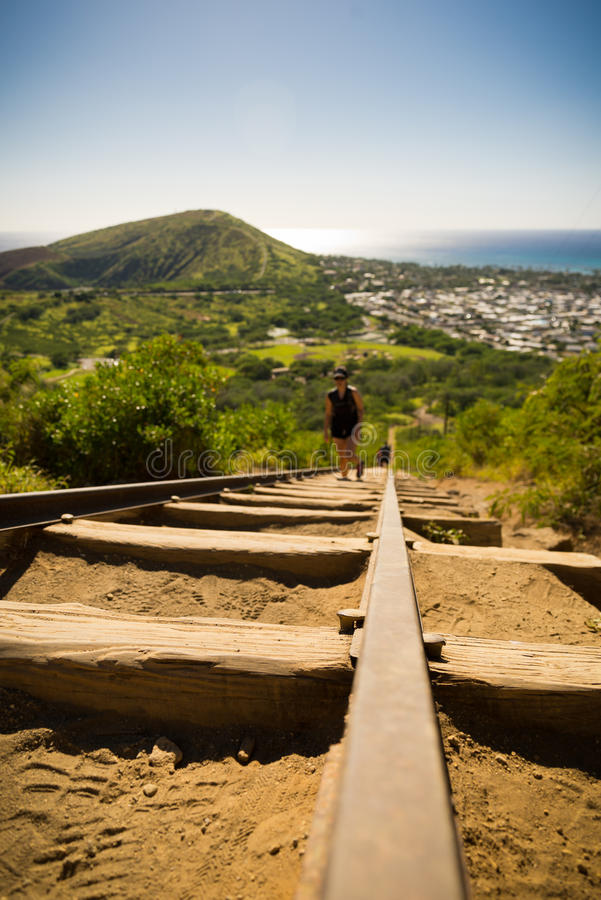 Koko Head Crater and hikers. Koko Head's Crater and hikers attempting to climb its 1048 steps royalty free stock images