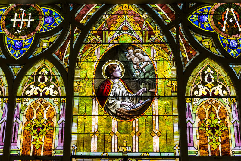 Kokomo - Circa November 2016: Church Stained Glass Portraying Cherubs and Saint Cecilia, the Patron Saint of Musicians II royalty free stock images