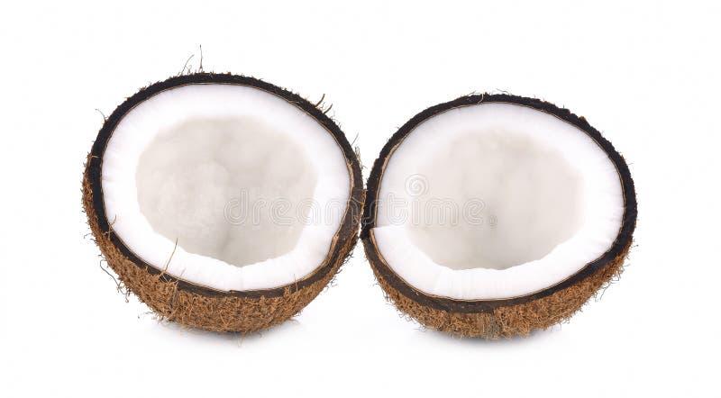 Kokosnöt med halva som isoleras på vit bakgrund royaltyfria foton