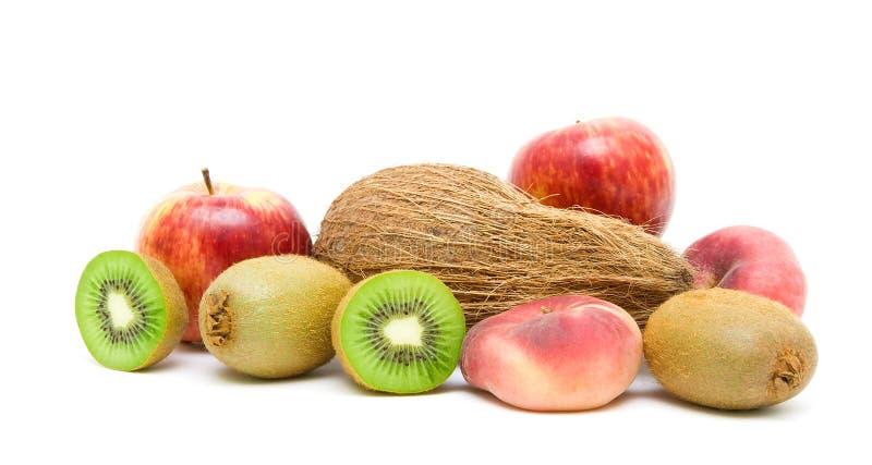 Kokosnöt och frukt som isoleras på vit bakgrund royaltyfri foto