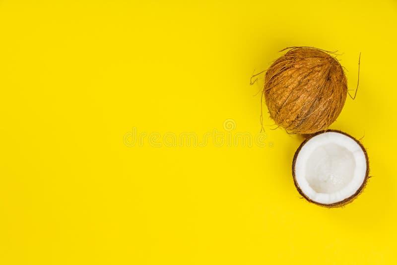 Kokosnötter på gul bakgrund royaltyfria bilder