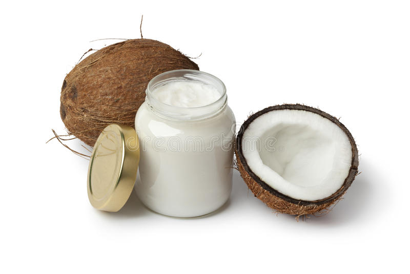 Kokosnotenolie en verse kokosnoot stock foto