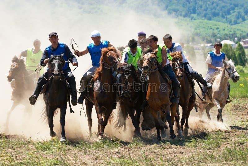 Kokpar - competiciones tradicionales de los caballos del nómada fotografía de archivo libre de regalías