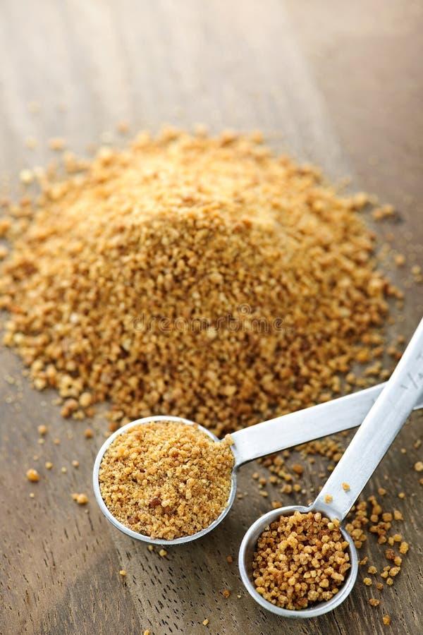 koksu pomiarowy palmowy łyżek cukier zdjęcie royalty free