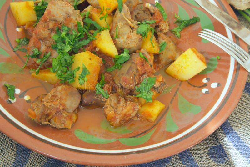 Kokta potatisar för ugn med feg lever royaltyfria foton