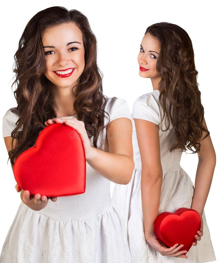 Kolaż trzyma sercowatego pudełko ładna młoda kobieta fotografia stock