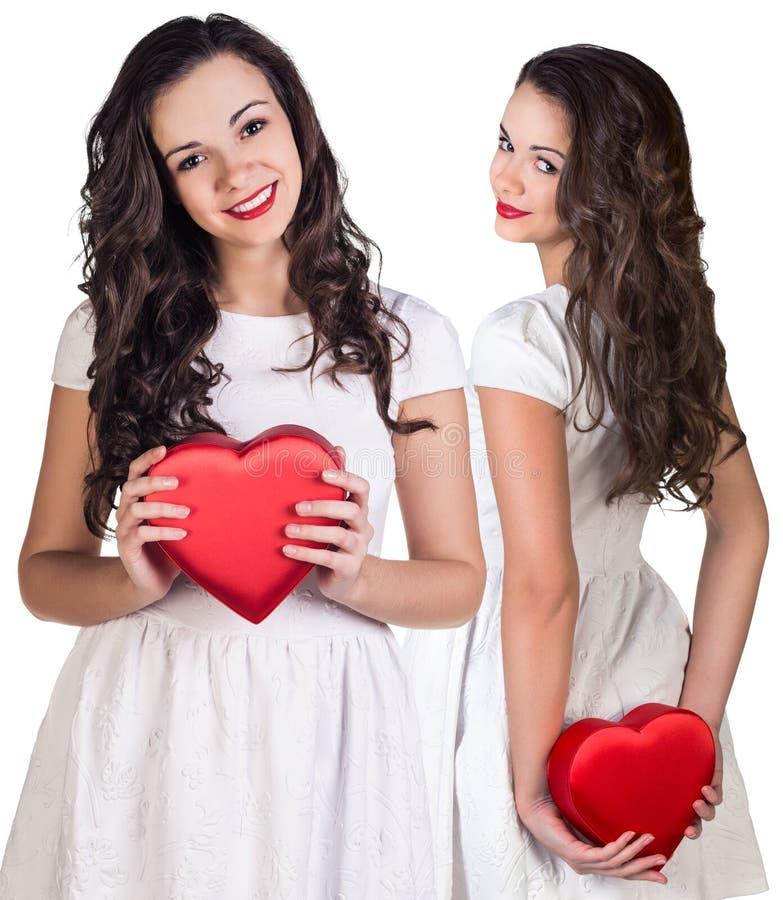 Kolaż trzyma sercowatego pudełko ładna młoda kobieta zdjęcie royalty free