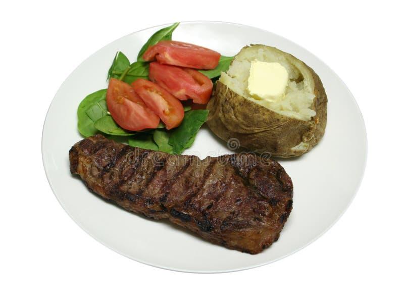 kolacja grillowany stek w izolacji zdjęcia stock