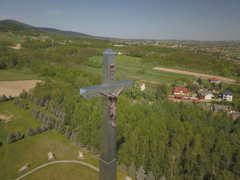Kolaczyce, Poland - may 10, 2018: A huge statue of the crucified Christ on a hill in the middle of the settlements. Religious sign stock photos