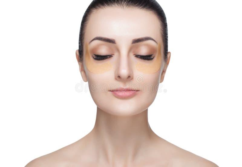 Kolagenu złota łaty na skórze powieka, czoło i podbródek na twarzy, obraz stock