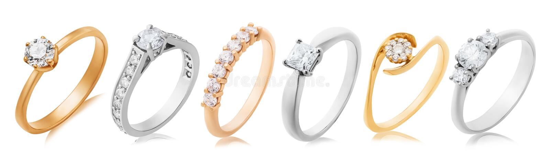 Kolekcja pierścieni zaręczynowych w żółtym i białym złocie z kamieniami szlachetnymi wyizolowanymi na tle obraz stock
