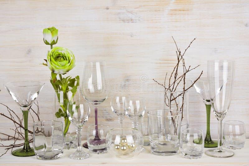 Kolekcja różnorodny glassware na drewnianym tle fotografia royalty free