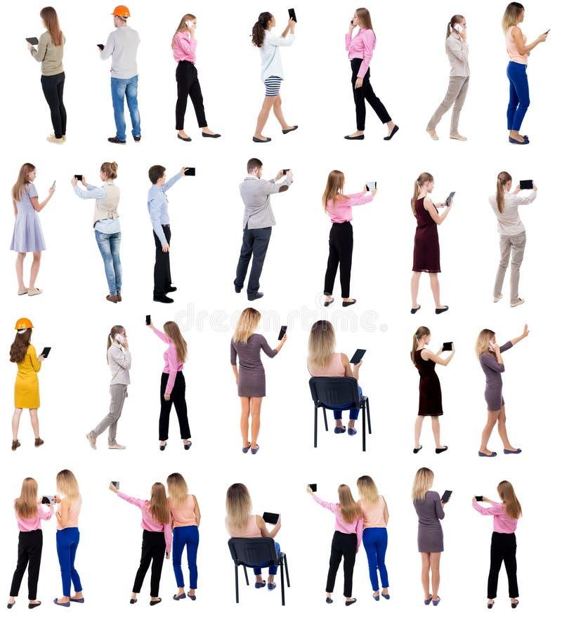 Kolekcja widoku Use pastylki i Smartphones Tylni ludzie zdjęcie royalty free