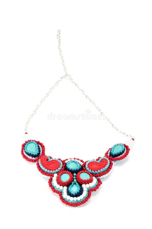 Kolie czerwieni i błękita handmade kolory fotografia royalty free