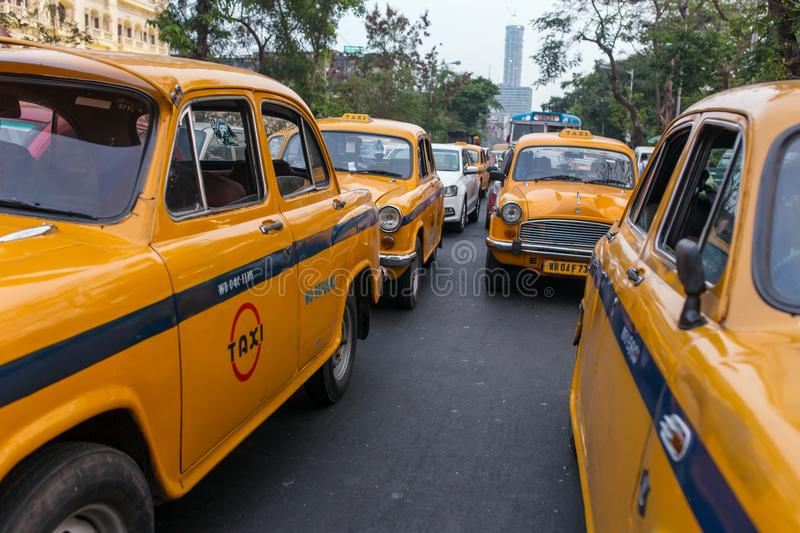 Famouse oldtimer yellow taxi on the streets of Kolkata, India. Kolkata, India - April 5, 2017: Famouse oldtimer yellow taxi on the streets of Kolkata, India stock photo