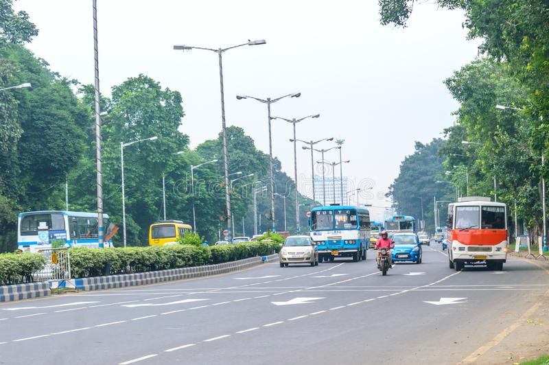 KOLKATA, INDIA, ASIA - 5 MAY 2017: City on a rush hour at daytime. Vehicals are moving forward on a busy city street and cars on r. Oad. Urban traffic. Outdoor stock photography