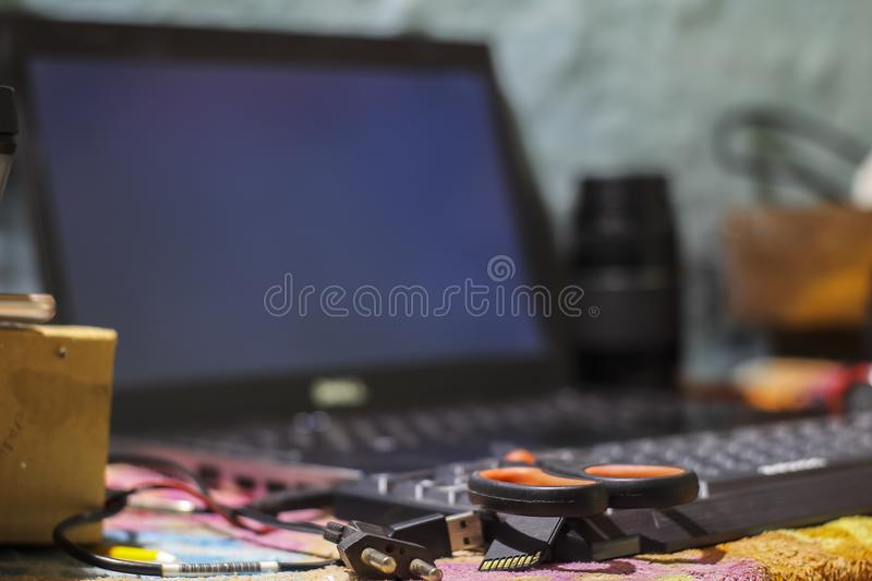 A branded laptop under a scissor royalty free stock image