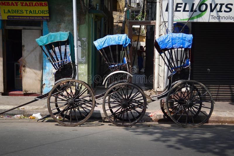 Three empty rickshaw carts on street royalty free stock photos