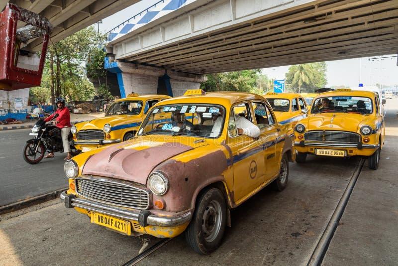 Yellow Ambassador taxi of Kolkata. India. Kolkata, India - March 12, 2019: Yellow Ambassador taxi of Kolkata on road stock images