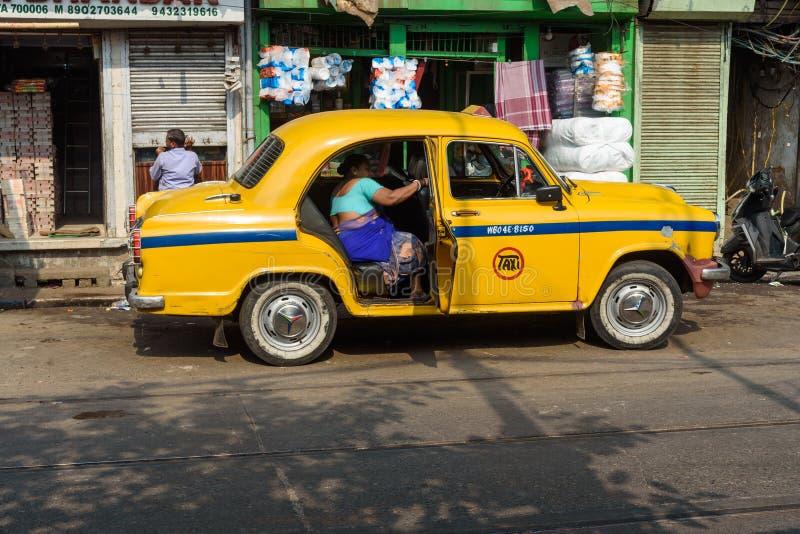 Yellow Ambassador taxi of Kolkata. India. Kolkata, India - March 14, 2019: Yellow Ambassador taxi of Kolkata on road stock image