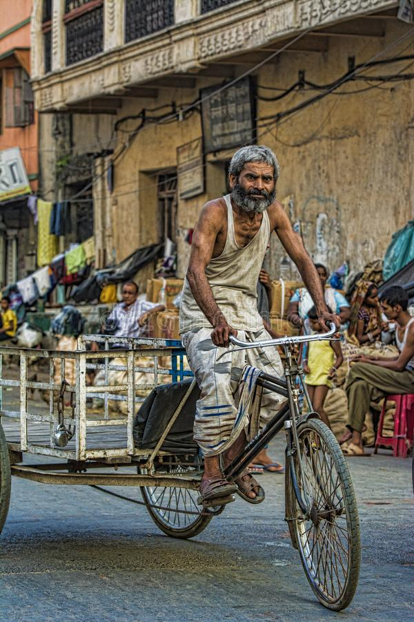 KOLKATA, INDIA, October 2014, Cycle rickshaw driver on road. KOLKATA, INDIA, October 2014 Cycle rickshaw driver on road royalty free stock image