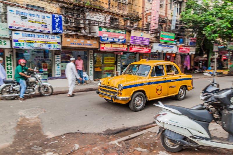 KOLKATA, INDIA - OCTOBER 27, 2016: View of yellow Hindustan Ambassador taxi in the center of Kolkata, Ind. Ia royalty free stock photography