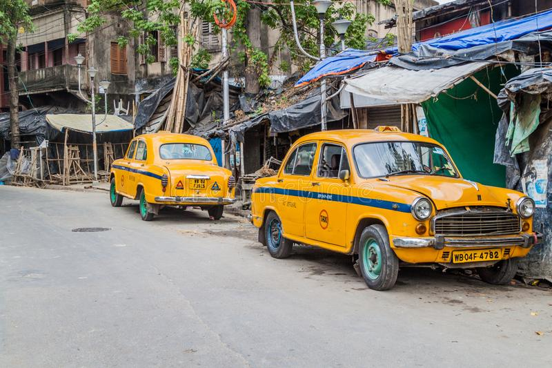 KOLKATA, INDIA - OCTOBER 31, 2016: View of yellow Hindustan Ambassador taxis in Kolkata, Ind. Ia stock image