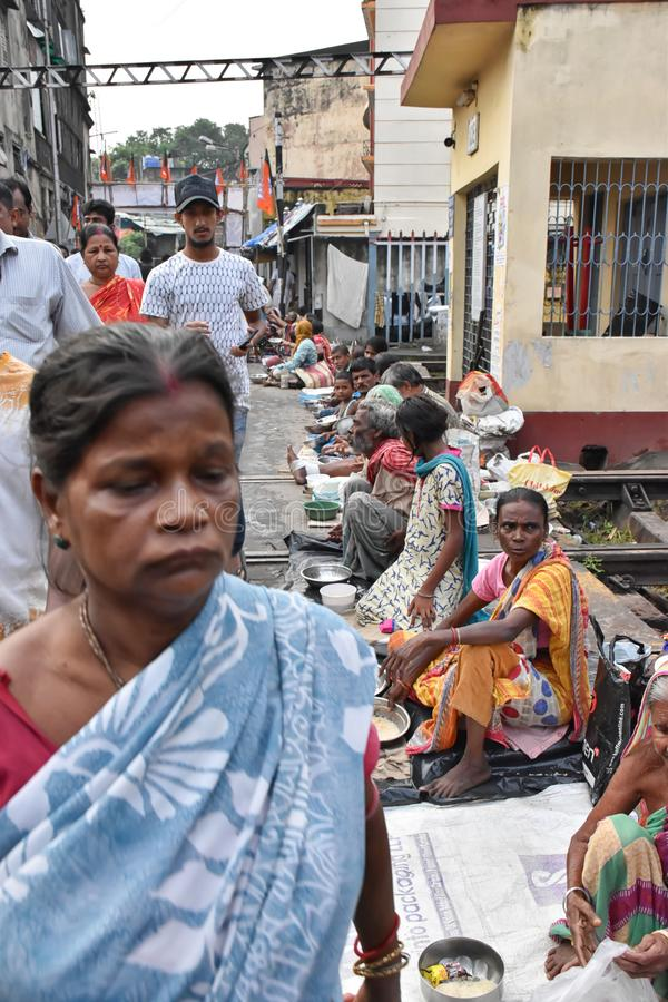 Kolkata, India – September 28 2019; Street beggar is sitting on the street asking for change in the occasion of. `Tarpan` at Mahalaya Paksha and Sola stock photo