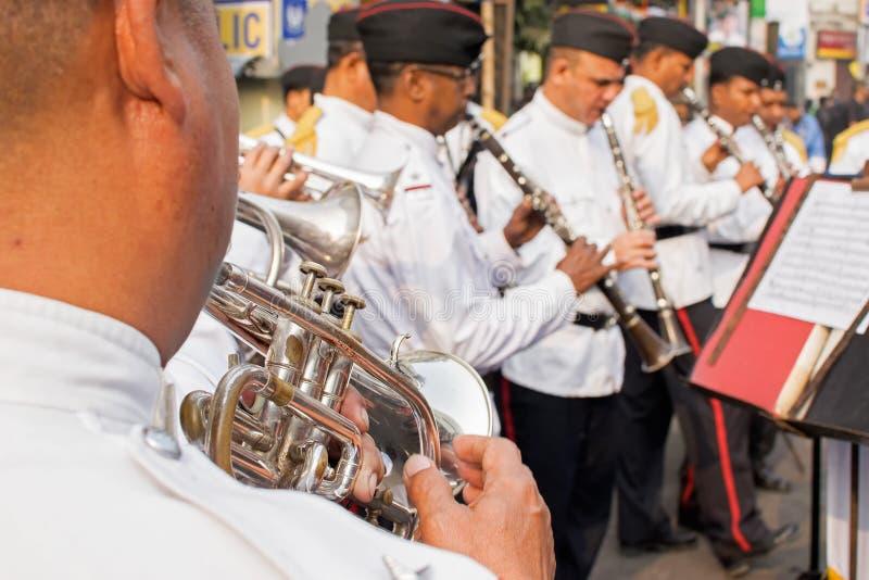 Kolkata Police force officers playing musical instruments. KOLKATA, WEST BENGAL , INDIA - FEBRUARY 7TH 2016 : Kolkata Police Force Officers, dressed in white and royalty free stock image