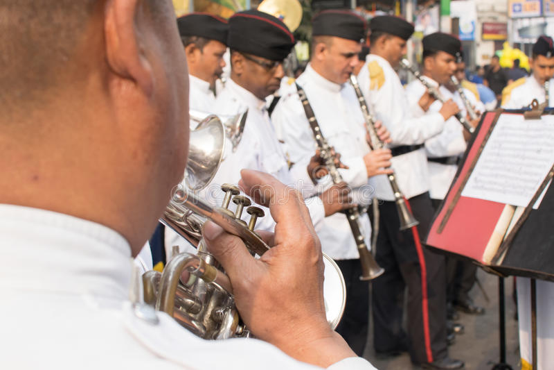 Kolkata Police force officers playing musical instruments. KOLKATA, WEST BENGAL , INDIA - FEBRUARY 7TH 2016 : Kolkata Police Force Officers, dressed in white and stock image