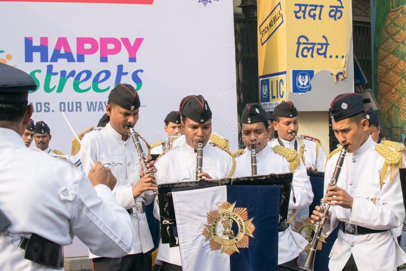 Kolkata Police force officers playing musical instruments. KOLKATA, WEST BENGAL , INDIA - FEBRUARY 7TH 2016 : Kolkata Police Force Officers, dressed in white and stock images