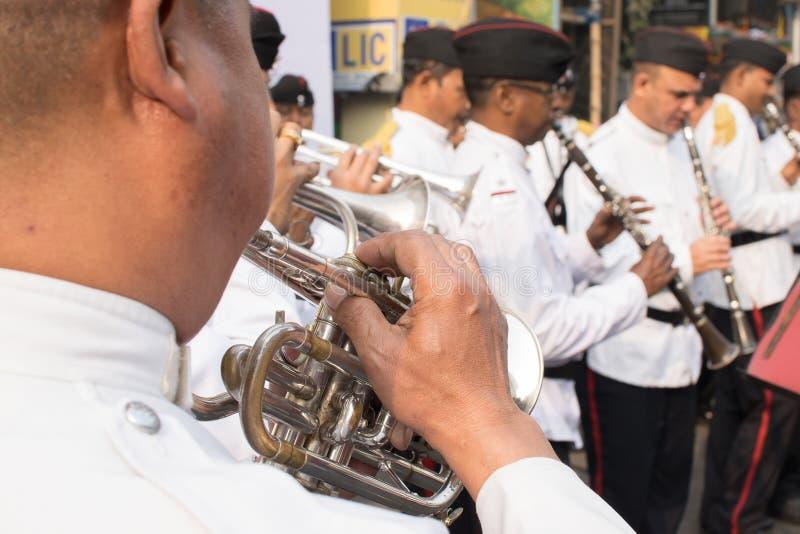 Kolkata Police force officers playing musical instruments. KOLKATA, WEST BENGAL , INDIA - FEBRUARY 7TH 2016 : Kolkata Police Force Officers, dressed in white and royalty free stock images