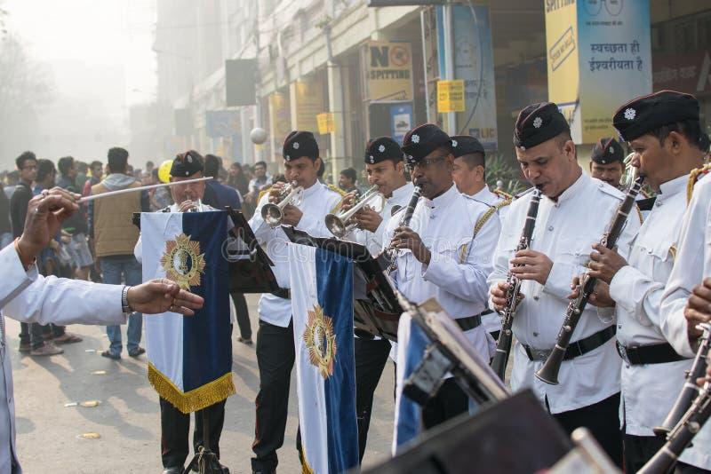 Kolkata Police force officers playing musical instruments. KOLKATA, WEST BENGAL , INDIA - FEBRUARY 7TH 2016 : Kolkata Police Force Officers, dressed in white and stock photo