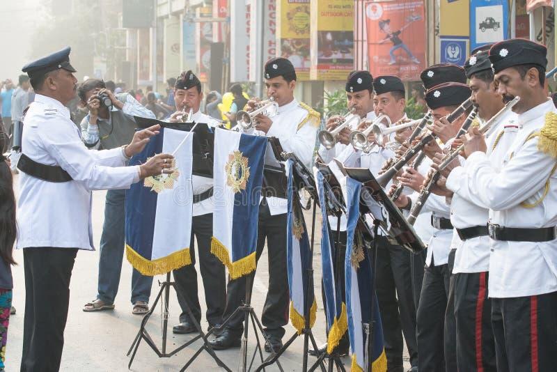 Kolkata Police force officers playing musical instruments. KOLKATA, WEST BENGAL , INDIA - JANUARY 17TH 2016 : Kolkata Police Force Officers, dressed in white and royalty free stock photo