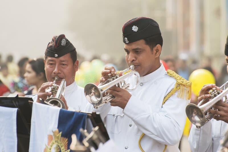 Kolkata Police force officers playing musical instruments. KOLKATA, WEST BENGAL , INDIA - JANUARY 17TH 2016 : Kolkata Police Force Officers, dressed in white and stock image