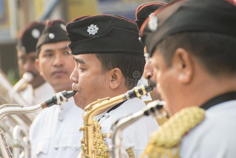 Kolkata Police force officers playing musical instruments. KOLKATA, WEST BENGAL , INDIA - JANUARY 17TH 2016 : Kolkata Police Force Officers, dressed in white and royalty free stock images