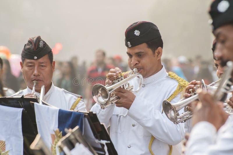 Kolkata Police force officers playing musical instruments. KOLKATA, WEST BENGAL , INDIA - JANUARY 17TH 2016 : Kolkata Police Force Officers, dressed in white and royalty free stock photos
